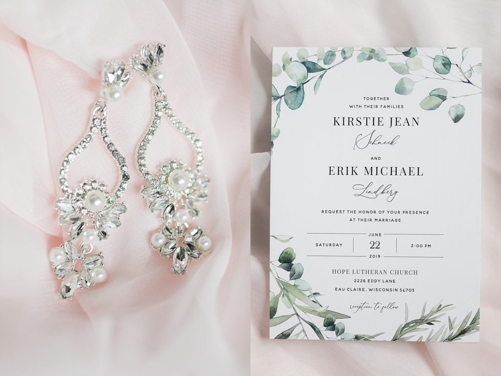 brides earrings and wedding invitation at The Florian Gardens in Eau Claire, WI