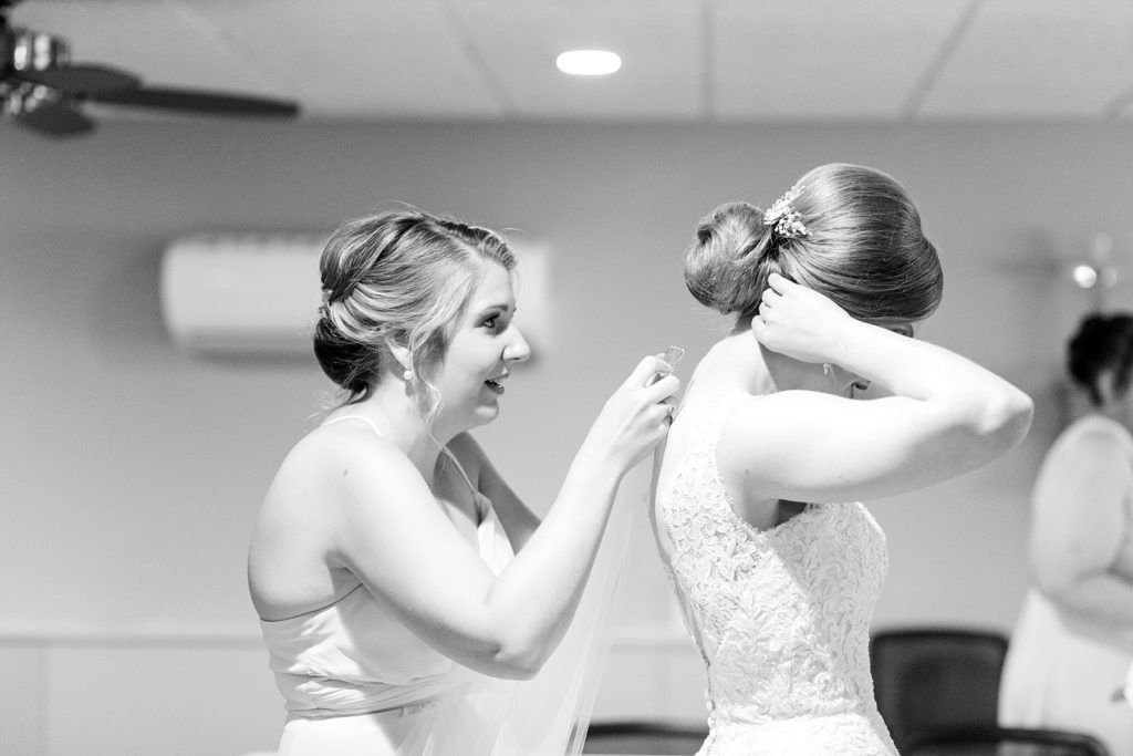 bride getting her veil put in at Hope Lutheran Church in Eau Claire