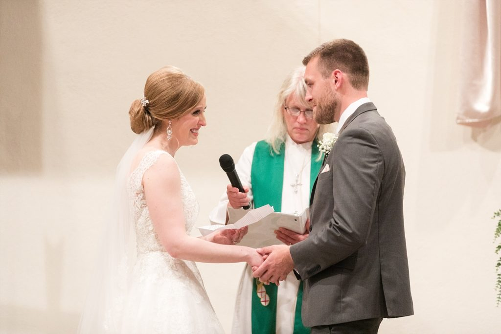 couple sharing their vows at Hope Lutheran Church in Eau Claire