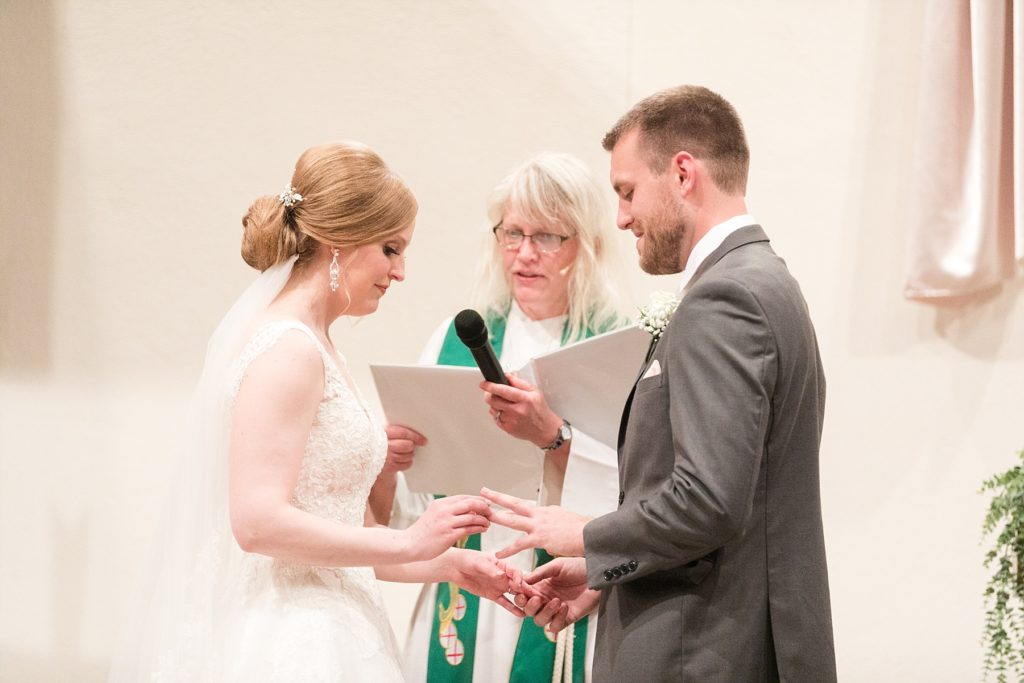 couple exchanging rings at wedding at Hope Lutheran Church in Eau Claire