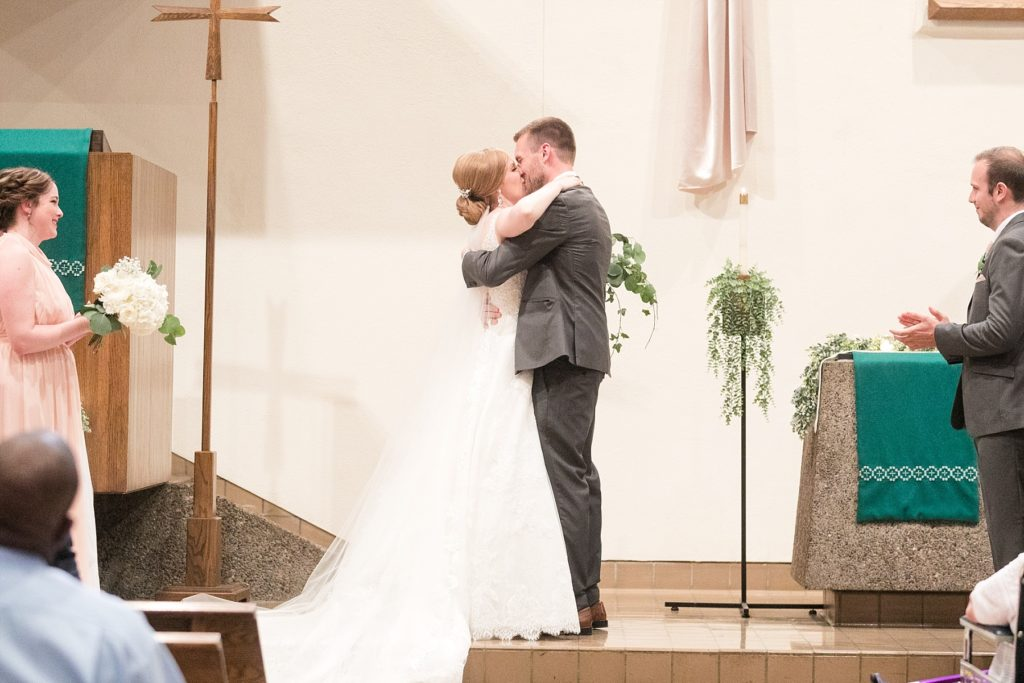 couple and their first kiss at Hope Lutheran Church in Eau Claire