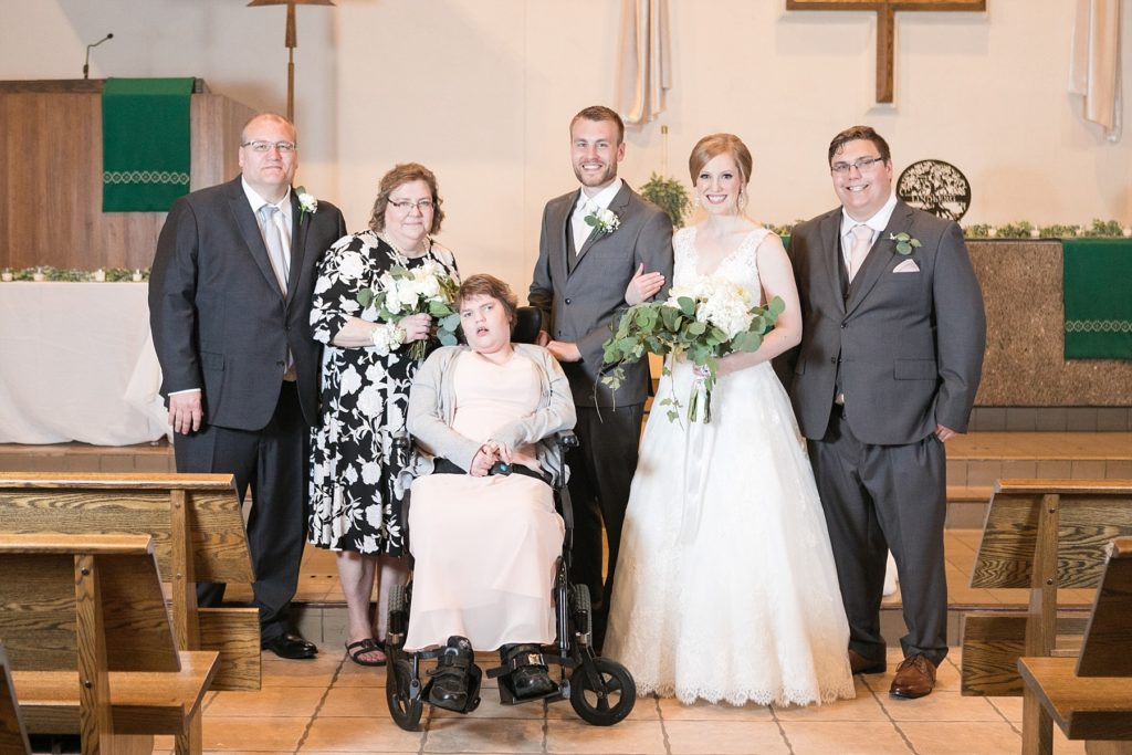 grooms family portrait at Hope Lutheran Church in Eau Claire