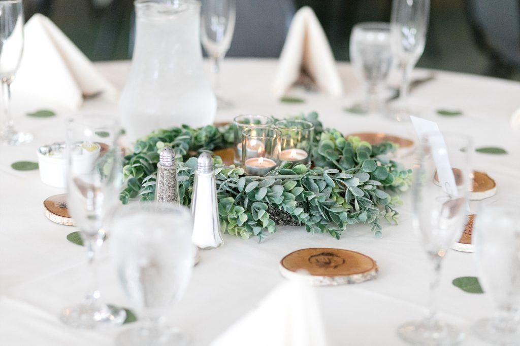 table decor of candles and wood slabs at wedding atThe Florian Gardens in Eau Claire