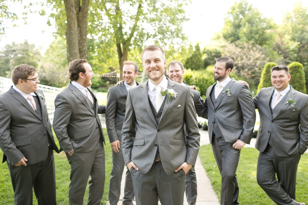 groom with groomsmen at wedding atThe Florian Gardens in Eau Claire