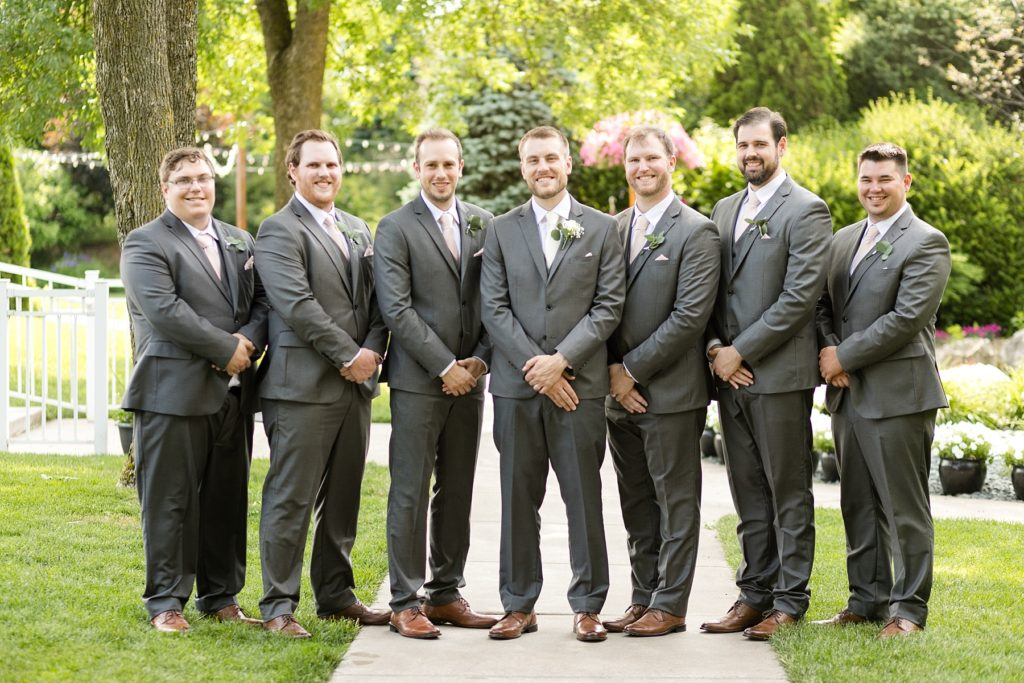 groom and groomsmen at wedding atThe Florian Gardens in Eau Claire
