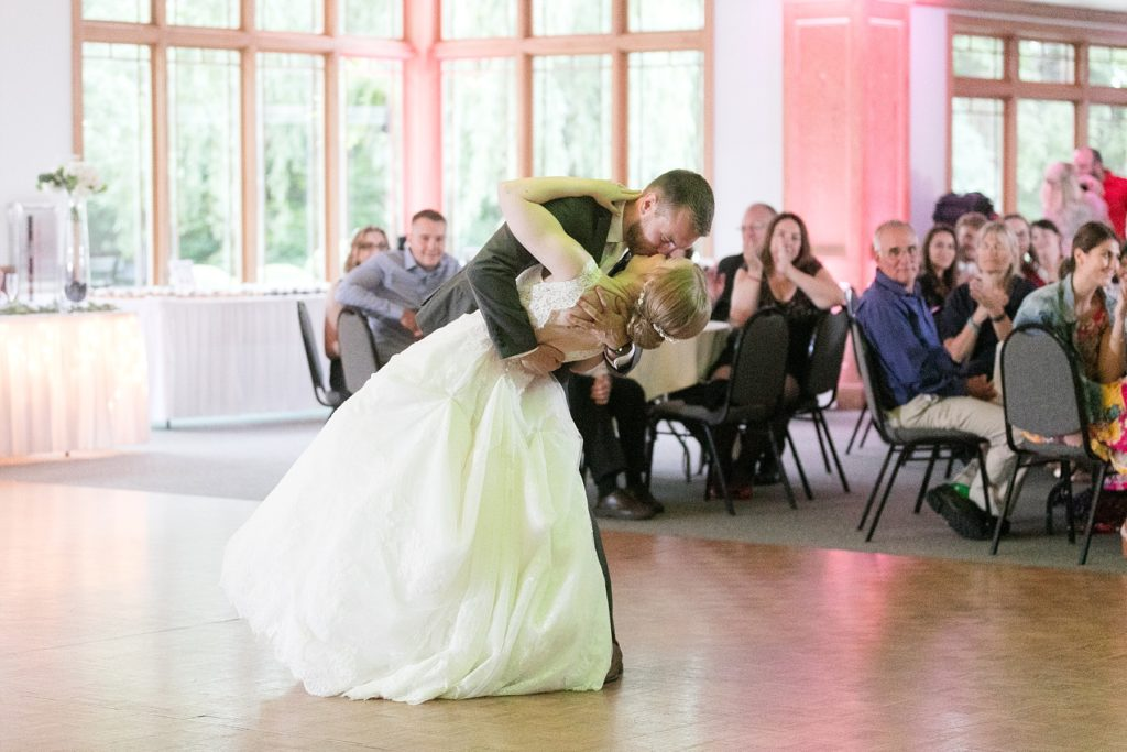 couple dipping during first dance at wedding atThe Florian Gardens in Eau Claire