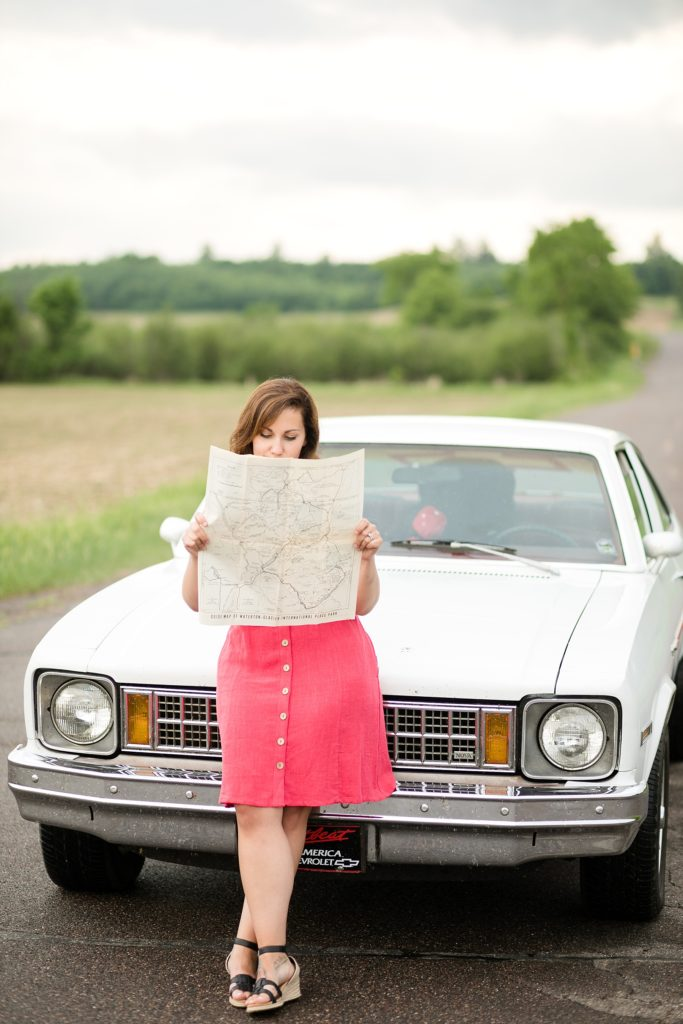 photographer with a map of Montana in front of a 77 Chevy Nova