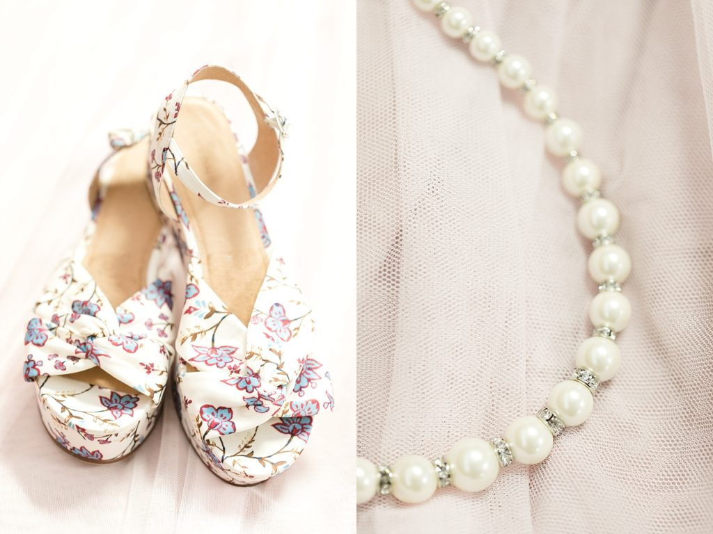 brides shoes and pearl necklace at a Wedding at the Eau Claire Golf & Country Club