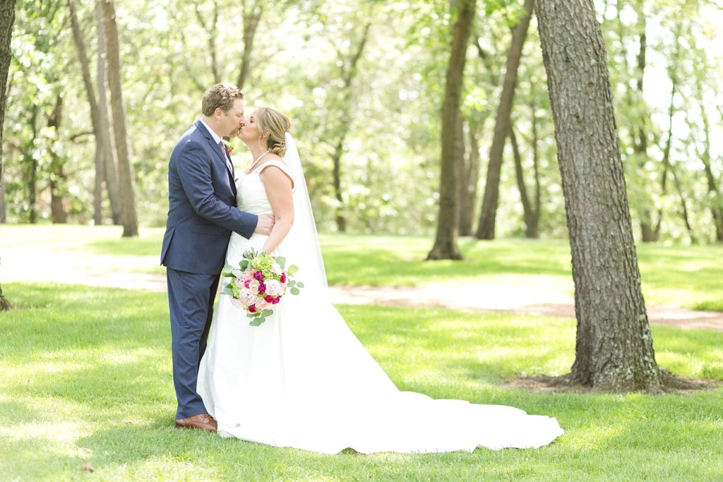 bride and groom portrait kissing at the Eau Claire Golf & Country Club