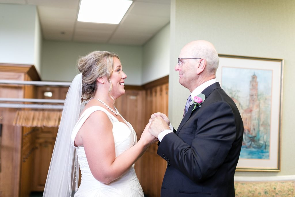 bride and father share a moment together before the wedding ceremony at the Eau Claire Golf & Country Club