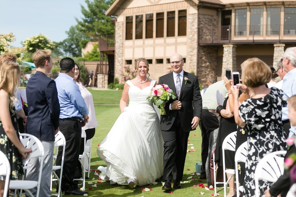 father walking daughter down the aisle at the Eau Claire Golf & Country Club
