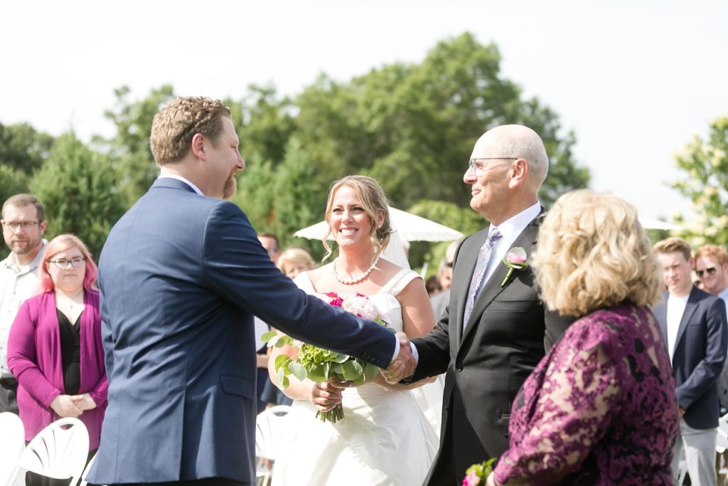 father giving away the bride at ceremony at the Eau Claire Golf & Country Club