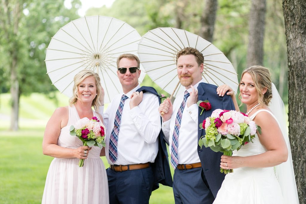 bridal party with umbrellas at the Eau Claire Golf & Country Club
