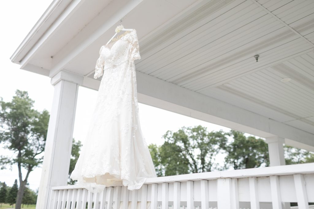 wedding dress hanging from the deck at Lake Wissota Golf & Events