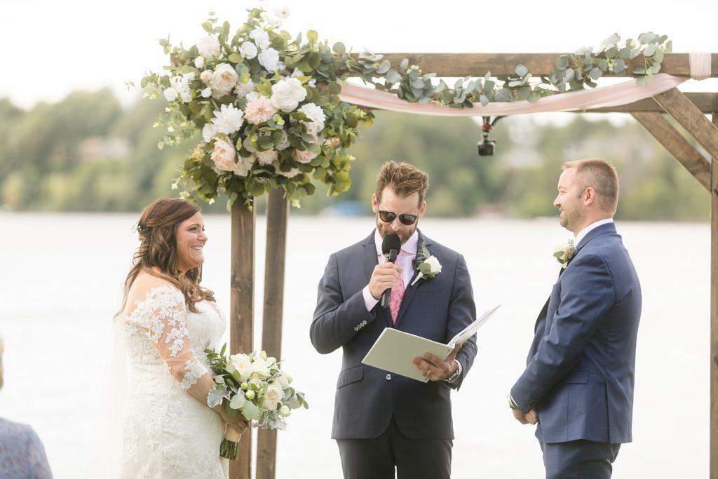wedding ceremony on the lake under a pergola at Lake Wissota Golf & Events