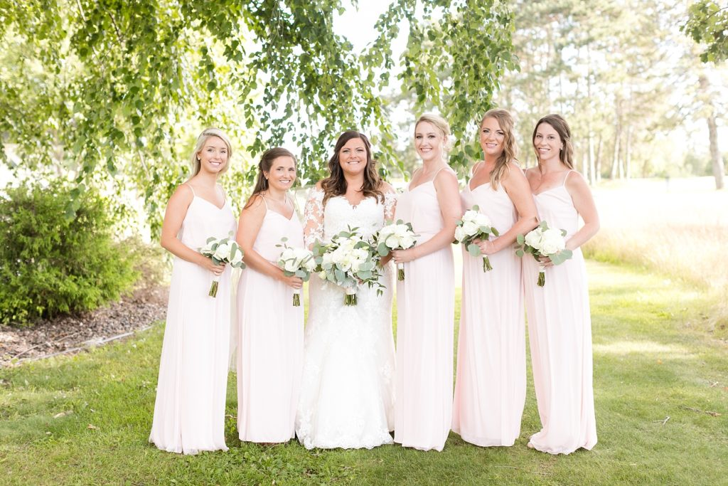 bridesmaids outside in blush dresses at Lake Wissota Golf & Events