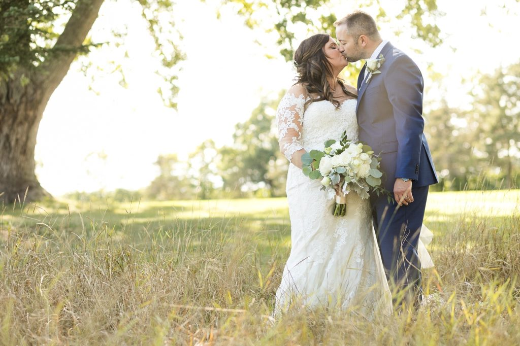 couple in the field at Lake Wissota Golf & Events