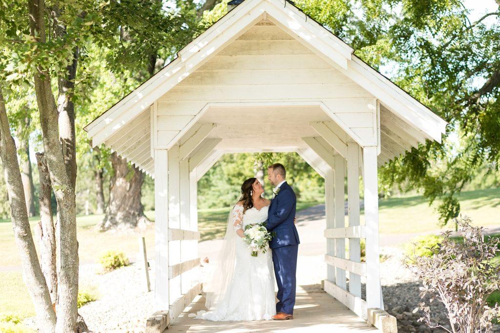 couple on the white bridge at Lake Wissota Golf & Events