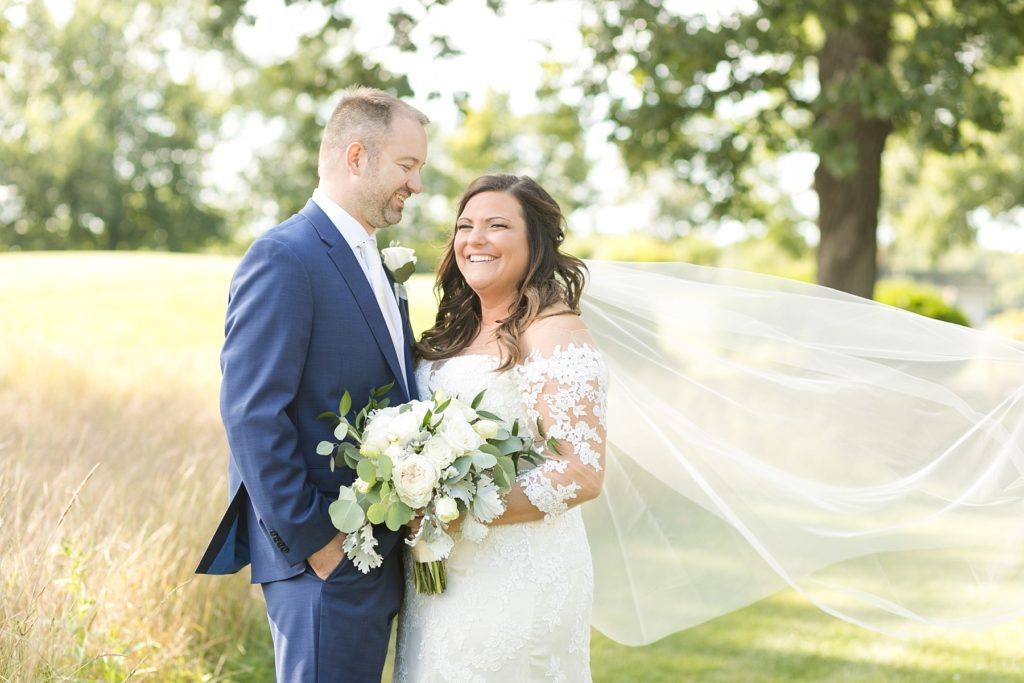 couple smiling and laughing at their wedding at Lake Wissota Golf & Events