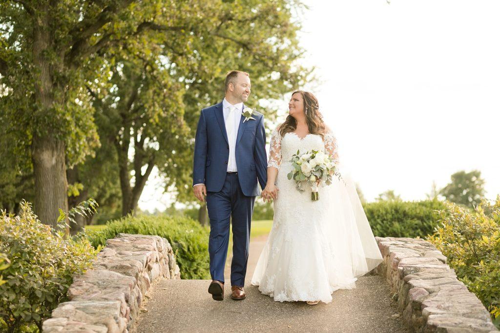 couple on the stone bridge at Lake Wissota Golf & Events