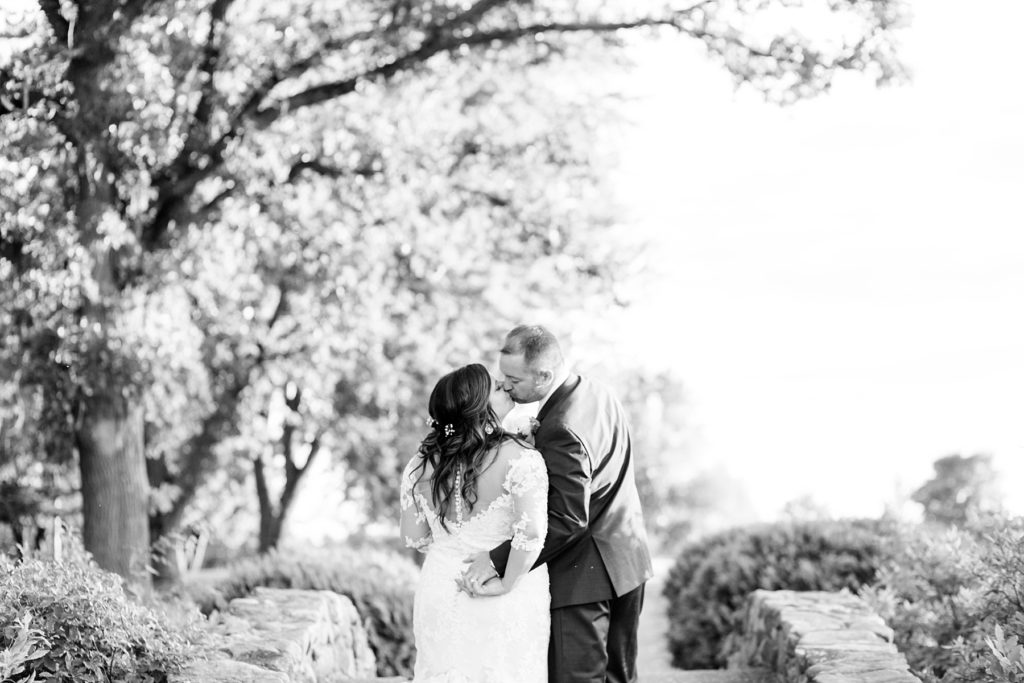 couple kissing with their back to the camera at Lake Wissota Golf & Events