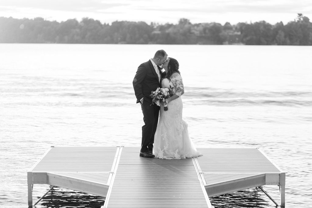 couple on the dock on their wedding day at Lake Wissota Golf & Events