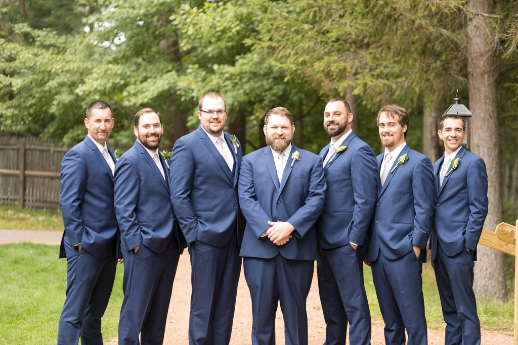 groom with groomsmen in blue suits at The Beacons in Minocqua