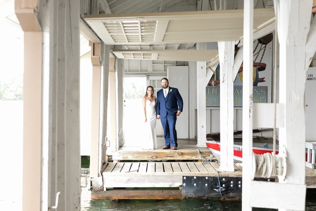 bride and groom in a boathouse at The Beacons of Minocqua on their wedding day