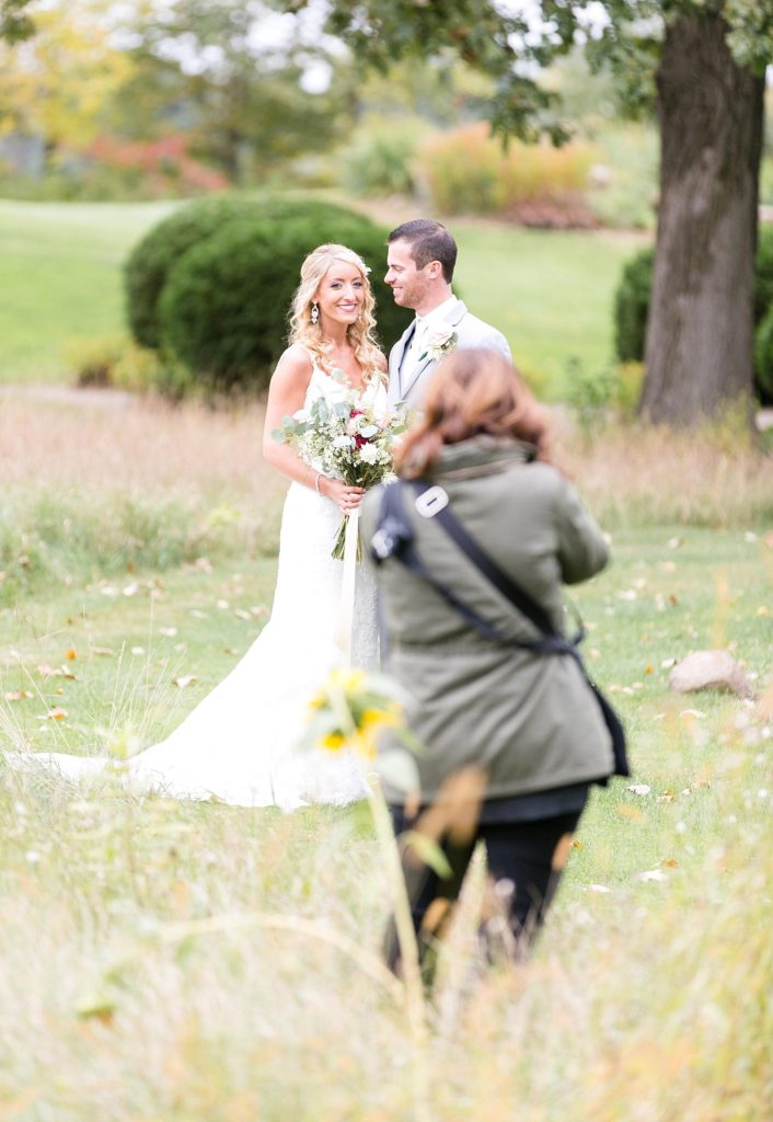 Photographer Christy Janeczko photographing a couple on their wedding day at Lake Wissota Golf & Events