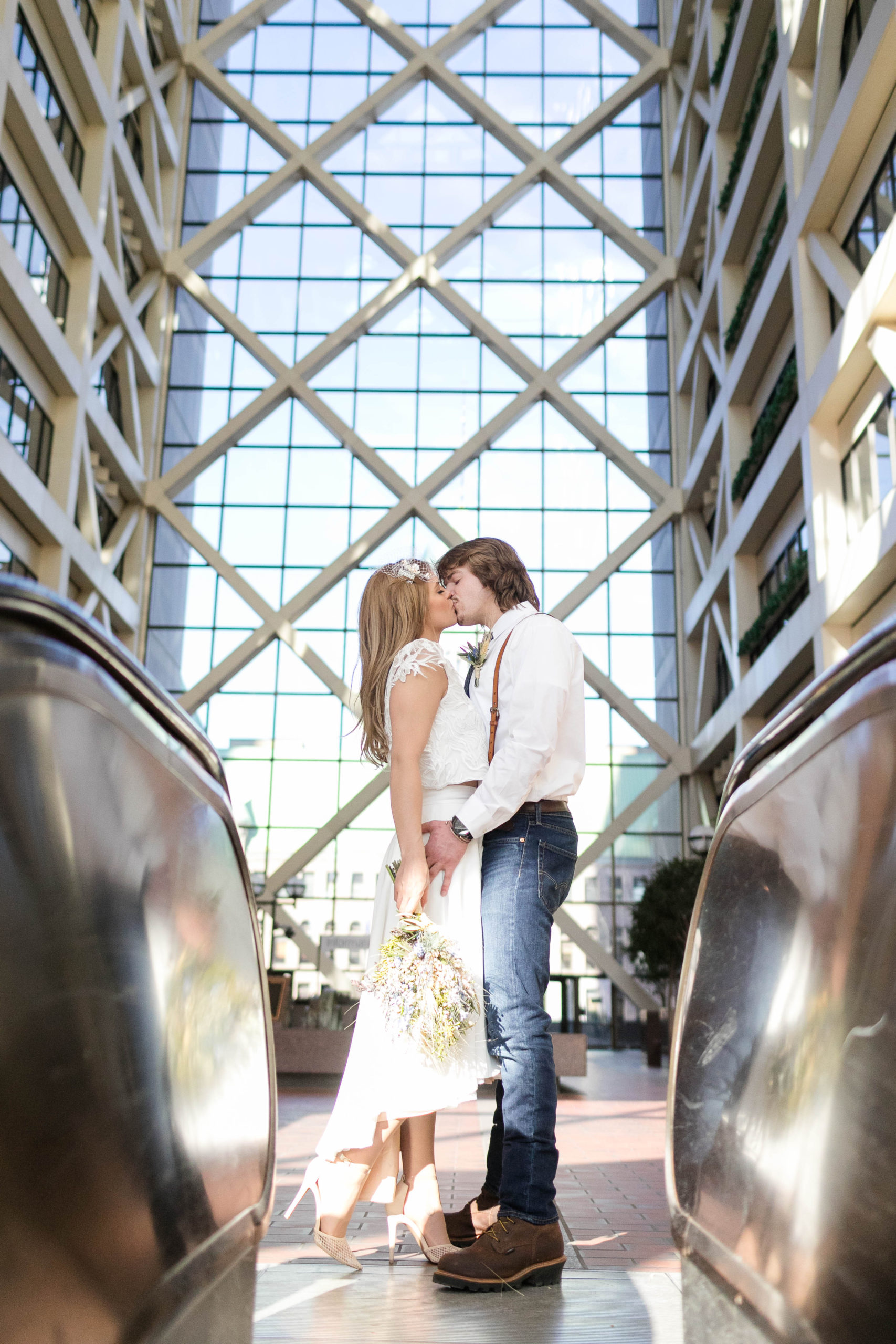 couple kissing in the atrium at the Hennepin County Government Center after having their Minneapolis courthouse wedding