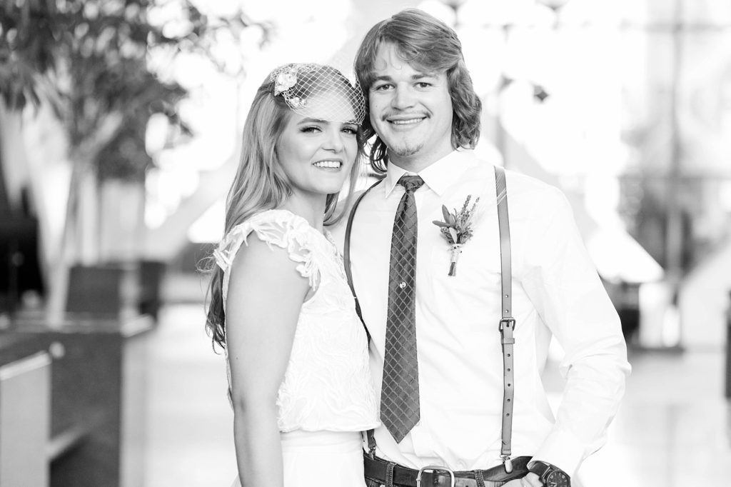 couple smiling in a black and white photo at the Hennepin County Government Center after having their Minneapolis courthouse wedding