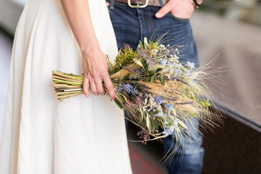bride holding her organic bouquet by Hive & Hollow of Menomonie at the Hennepin County Government Center after having their Minneapolis courthouse wedding