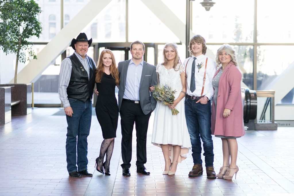 family photos after ceremony at the Hennepin County Government Center after having their Minneapolis courthouse wedding
