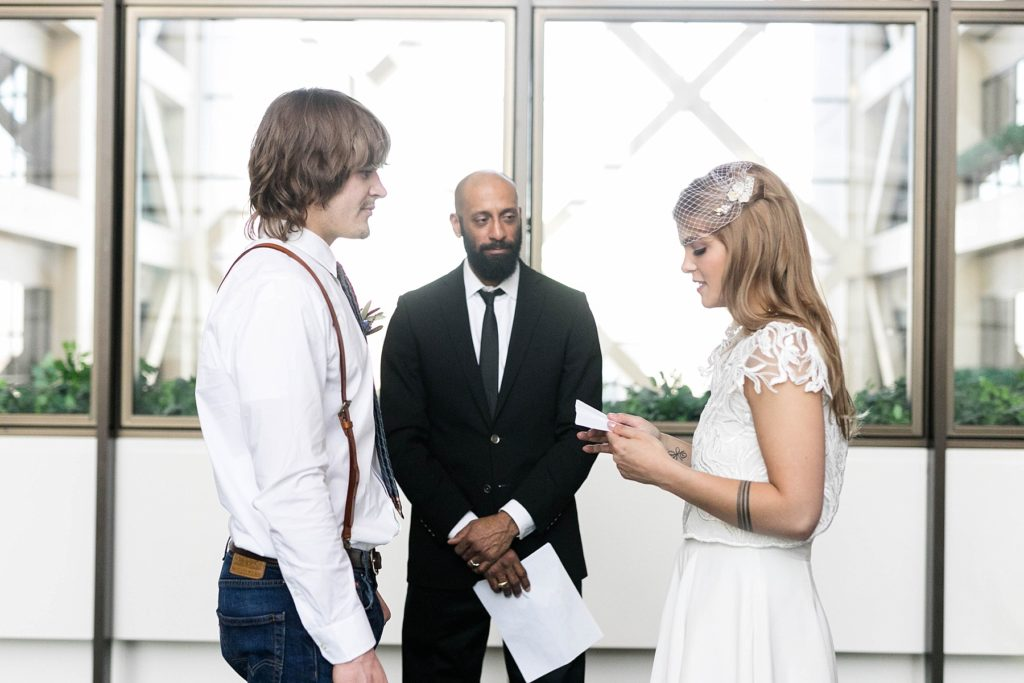 couple reading each other their vows at the Hennepin County Government Center after having their Minneapolis courthouse wedding