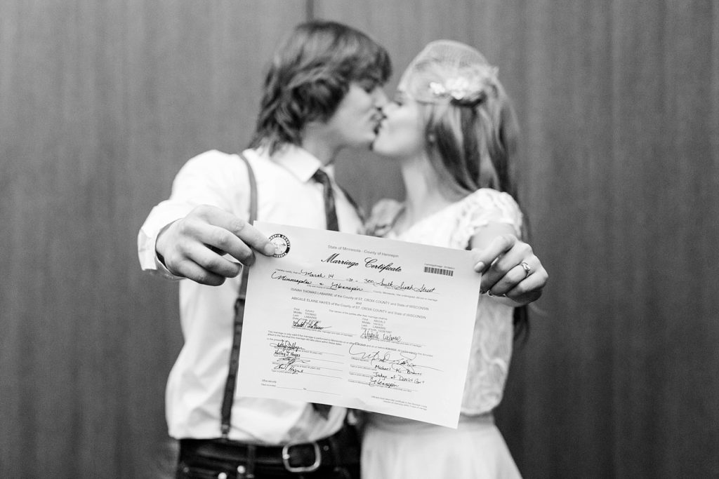 couple kissing in a courtroom at the Hennepin County Government Center after having their Minneapolis courthouse wedding