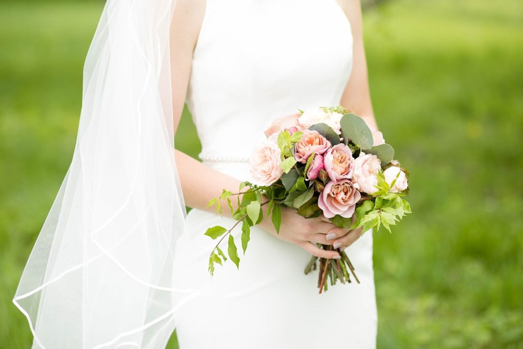bride holding a handmade bouquet in Rice Lake, WI at Turtleback Golf