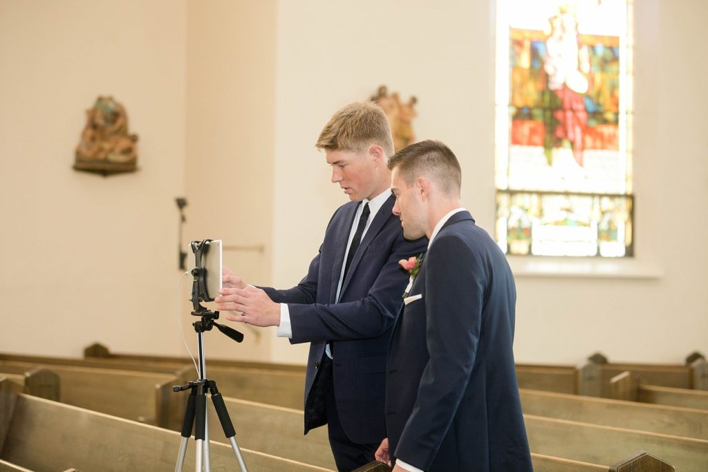 two guys getting ready to live stream a wedding ceremony using Facebook in Rice Lake, WI