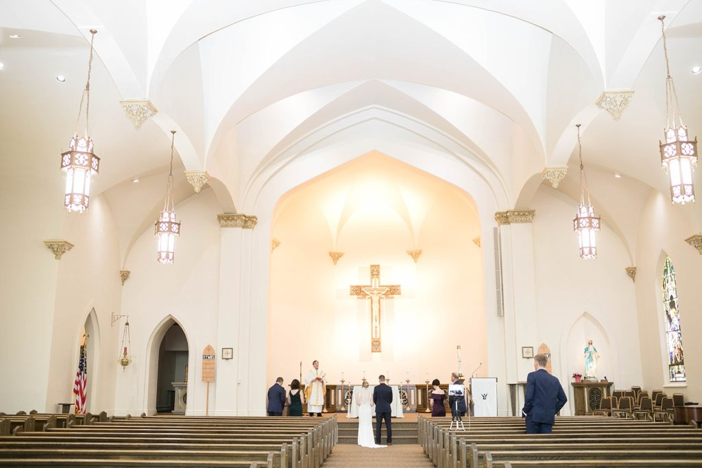 wedding ceremony with eight people at St. Joseph Catholic Church in Rice Lake,. WI