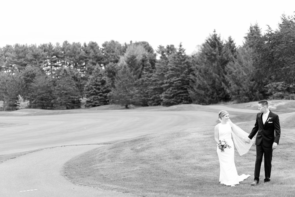 couple in black and white photo on their wedding day in Rice Lake, WI at Turtleback Golf