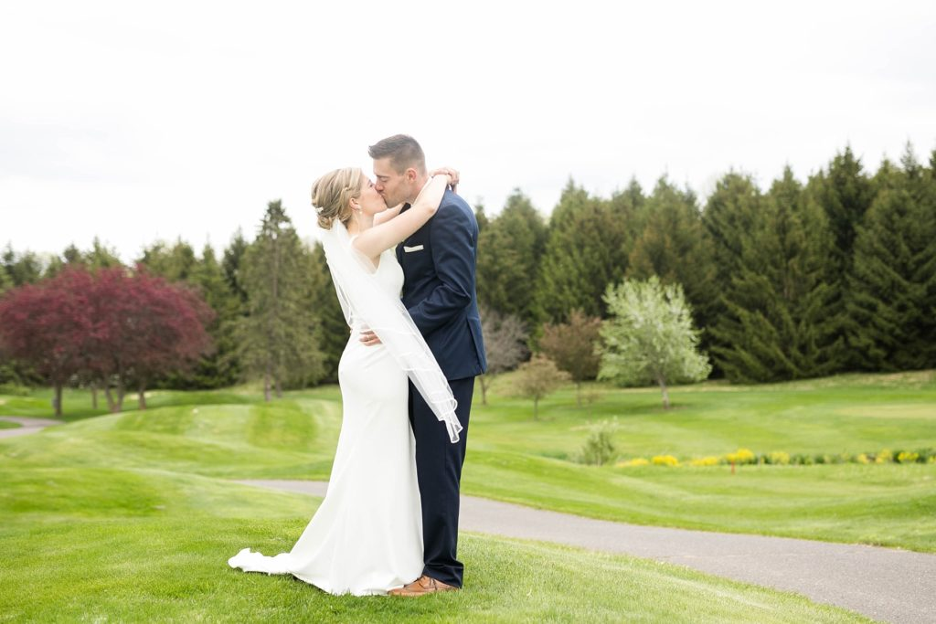 couple kissing on their wedding day in Rice Lake, WI at Turtleback Golf