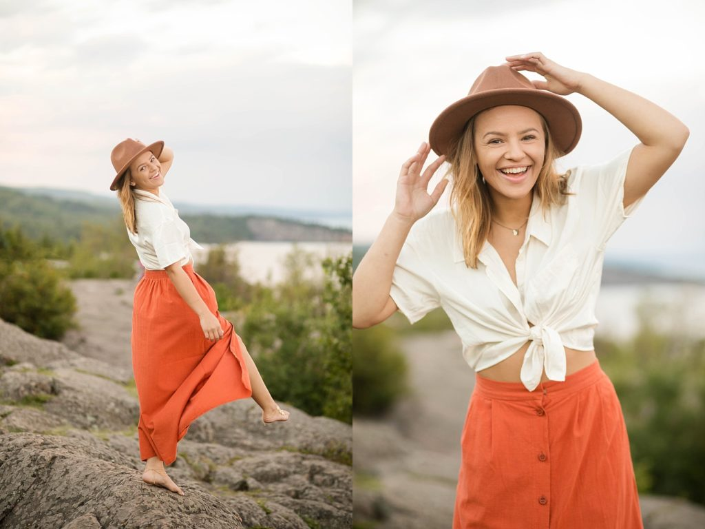 girl laughing at Palisade Head near Silver Bay, MN for her senior photos