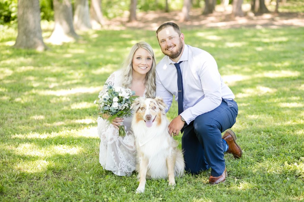 thorp wi micro wedding, couple poses with their dog