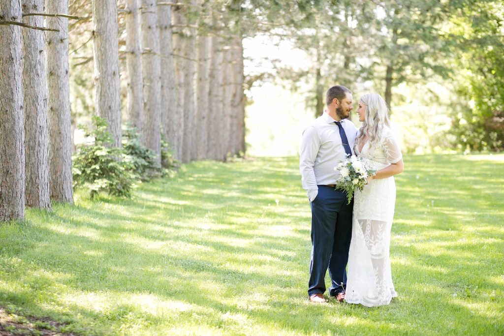 couple smiling at each other in a springtime micro wedding in Thorp, WI