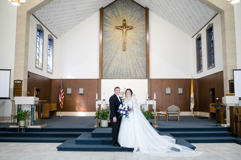 formal portrait of the bride and groom at Immaculate Conception Church in Eau Claire