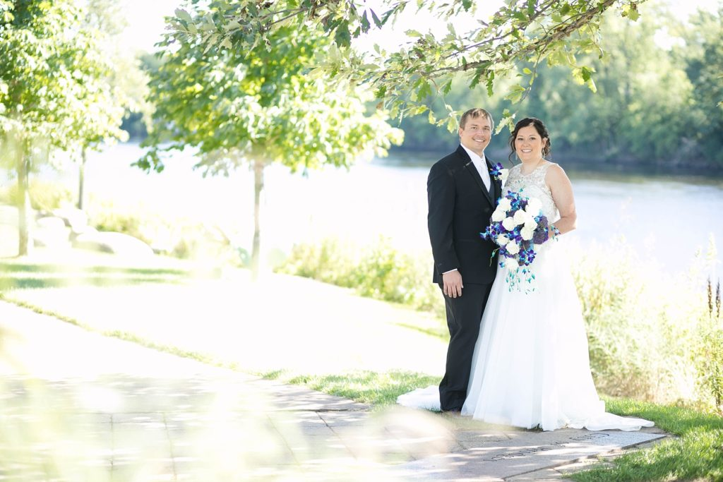 bride and groom smiling at Eau Claire micro wedding in Phoenix Park