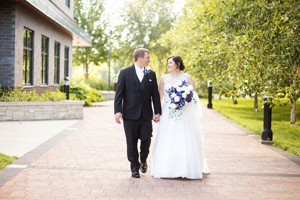 couple walking at Eau Claire micro wedding in Phoenix Park