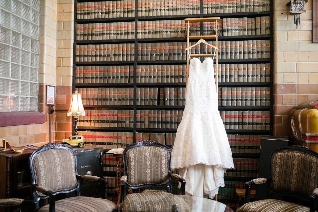 wedding at the Worden Avenue Exchange in Ladysmith WI wedding dress hanging in library