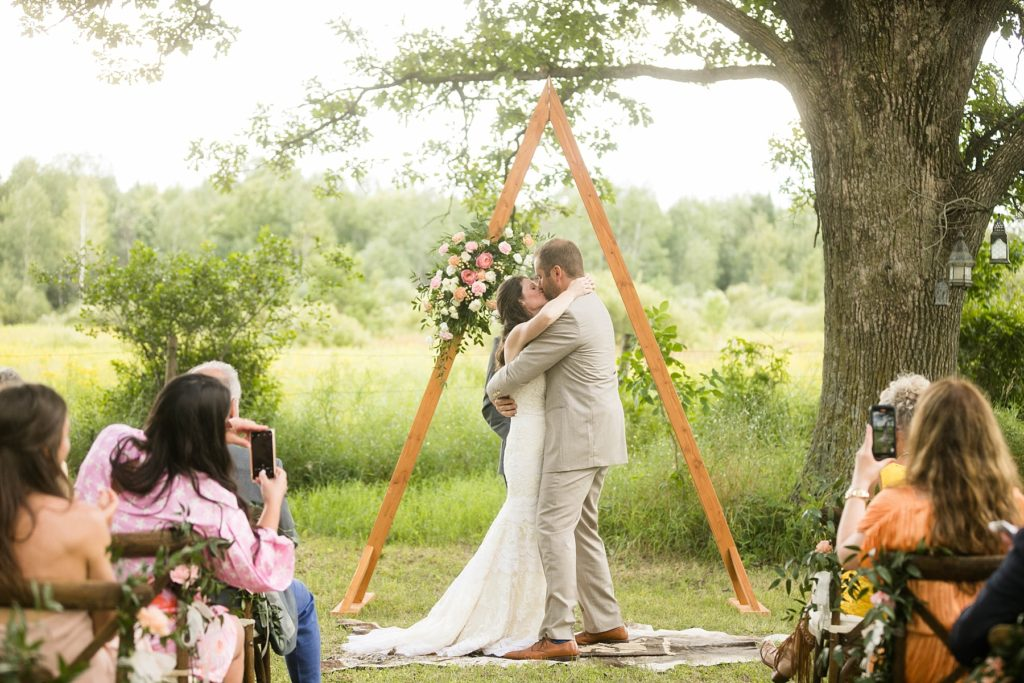 couple married in a field intimate childhood home wedding in Ladysmith, WI