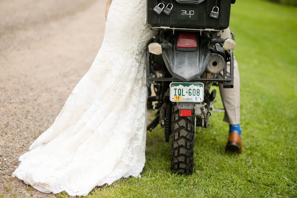couple on motorbike with Colorado plates on their wedding day