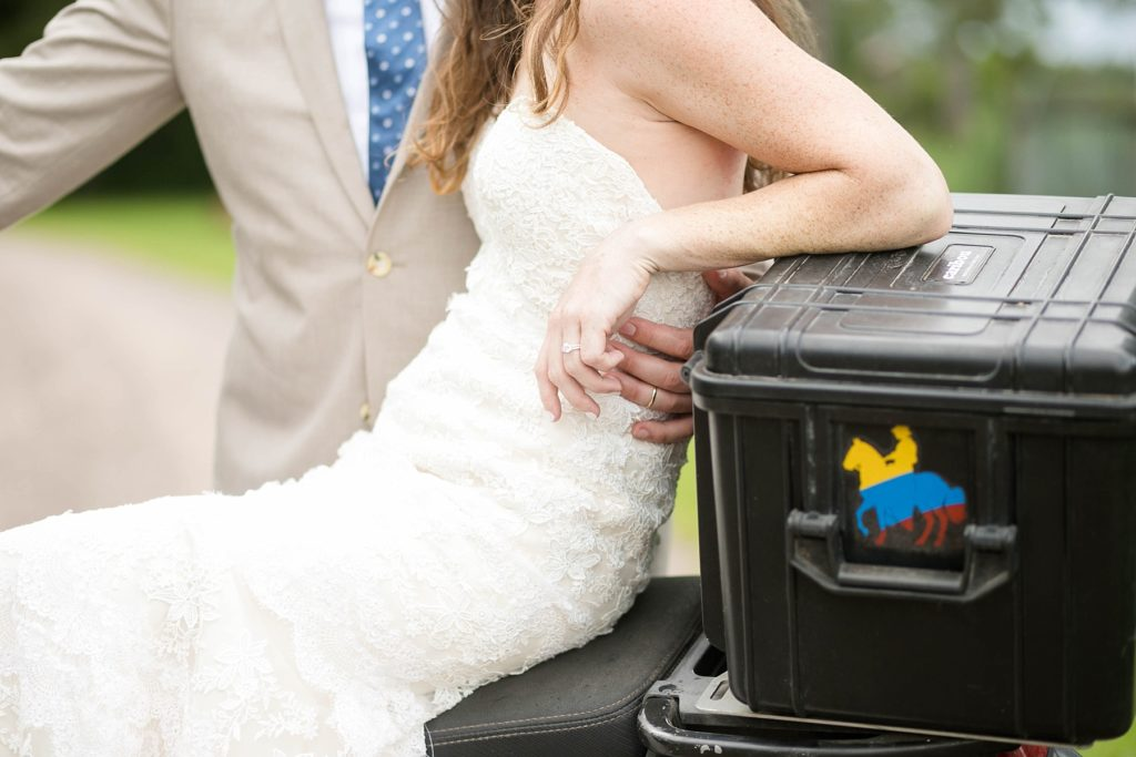 couple sitting on a motorcyle on their wedding day